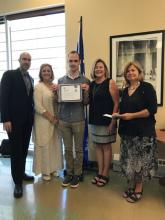 Stephane Lemoing receives an award from the city of Lachine